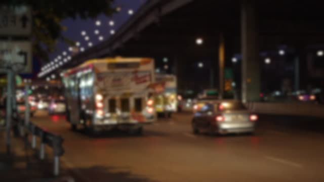 Thailand Traffic bus and car in city blur mode
