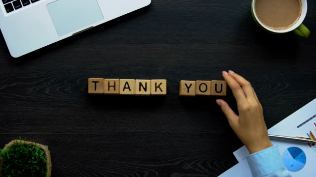 thank you, business woman making phrase of cubes, companys gratitude to client - thank you stock videos and b-roll footage