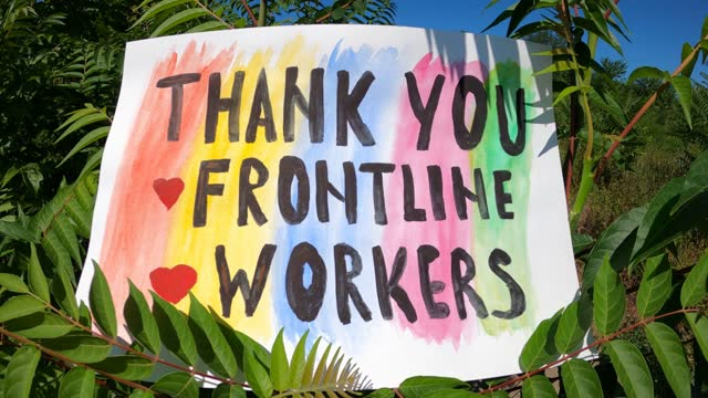 Thank You Frontline Workers - banner on the grass. You have the most difficult job - thanks to all the main employees! thank you stock videos & royalty-free footage