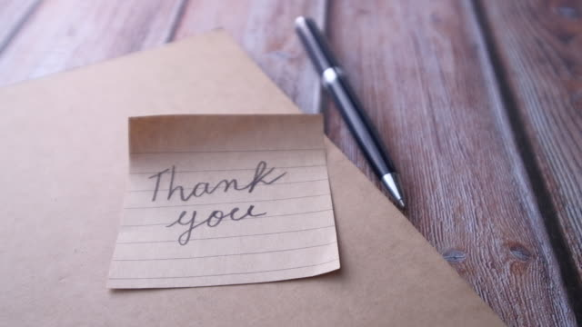thank you note on notepad Close up of thank you note on notepad thank you stock videos & royalty-free footage