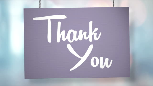 Thank you sign hanging from ropes. Luma matte included so you can put your own background. video