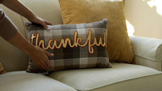 Thankful Pillow placed on couch