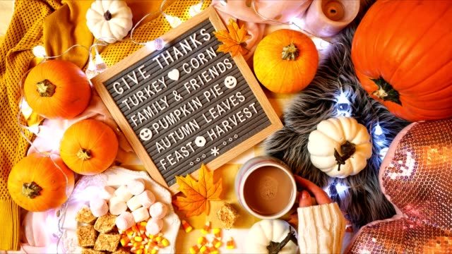 Thanksgiving in bed flatlay overhead with letter board Giving Thanks message.