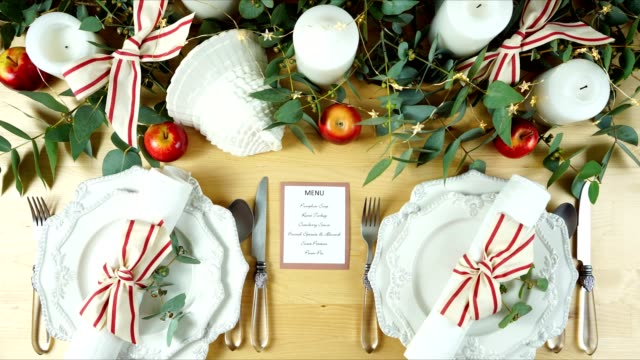 Thanksgiving modern elegant red and white table setting flat lay stop motion.