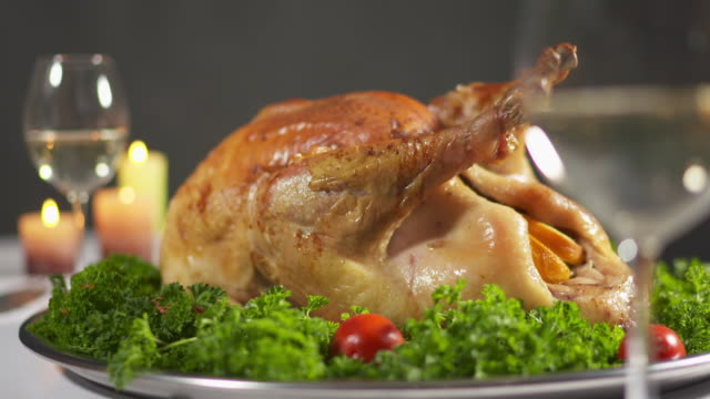 Thanksgiving or Christmas turkey dinner. Roasted turkey steaming on tray video