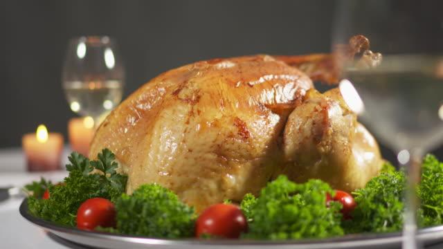 thanksgiving or christmas turkey dinner. whole roasted turkey steaming on tray - indyk pieczony filmów i materiałów b-roll
