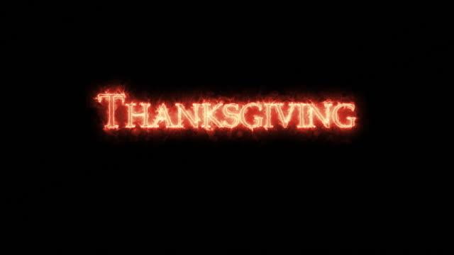 thanksgiving written with fire. loop - call center стоковые видео и кадры b-roll