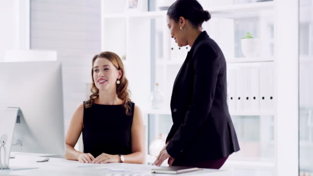 That's a brilliant idea! 4k video footage of two attractive businesswomen giving each other a high five after a successful meeting in the office good news stock videos & royalty-free footage