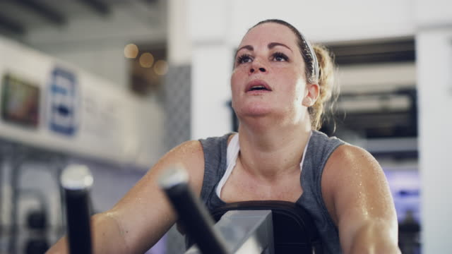 That's enough exercise for today… 4k footage of a woman looking exhausted after her workout at the gym exhaustion stock videos & royalty-free footage
