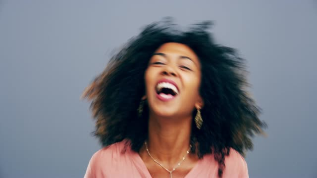 That's hilarious 4k video footage of a woman laughing against a gray background mouth open stock videos & royalty-free footage