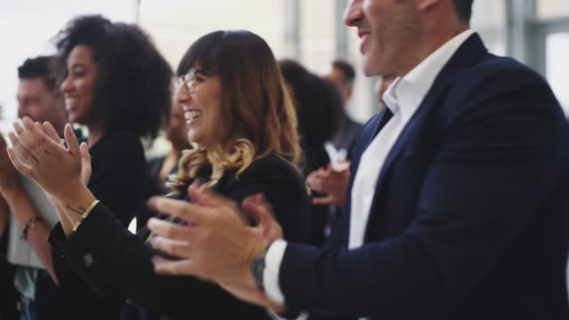 That's worth a standing ovation 4k video footage of businesspeople applauding while attending a conference event stock videos & royalty-free footage
