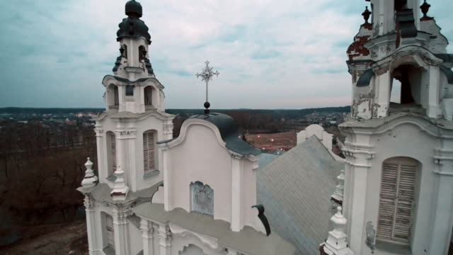 the aerial drone view of the catholic cathedral of the saint michael archangel, xviii-xix centuries, in the ivyanets city, belarus, eastern europe. - białoruś filmów i materiałów b-roll