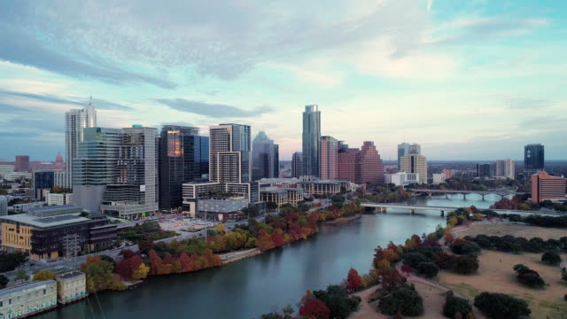 The aerial drove view of Austin Downtown, Texas, USA, from Auditorium Shores at Town Lake Park across Colorado River. Aerial drone video with the panoramic camera motion. The aerial drove view of Downtown of Austin, Texas, USA. 4K UHD aerial video footage. texas stock videos & royalty-free footage