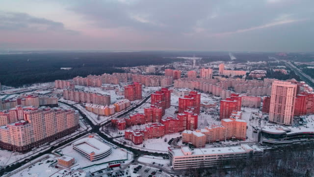 the aerial panoramic view on the residential district with multistorey apartment buildings in the big city. descending camera motion - беларусь стоковые видео и кадры b-roll