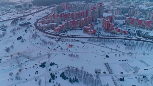 the aerial panoramic view on the residential district with multistorey apartment buildings in the big city. panoramic upward camera motion - беларусь стоковые видео и кадры b-roll