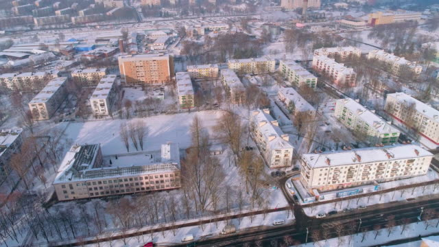 the aerial panoramic view on the winter city covered by the snow in the bright cold sunny day - białoruś filmów i materiałów b-roll
