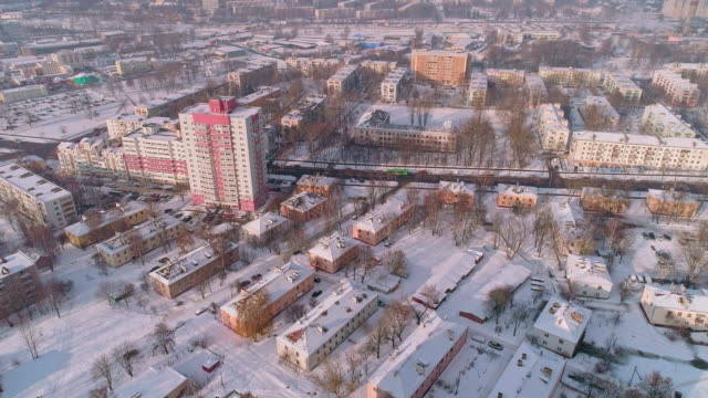the aerial panoramic view on the winter city covered by the snow in the bright cold sunny day - беларусь стоковые видео и кадры b-roll
