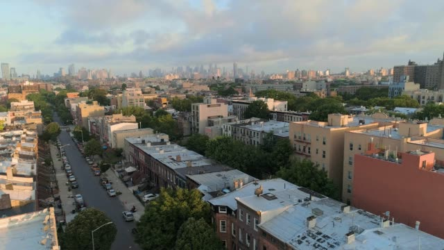 The aerial scenic remote view from Brooklyn, over the residential district, toward Manhattan. Panoramic camera motion.