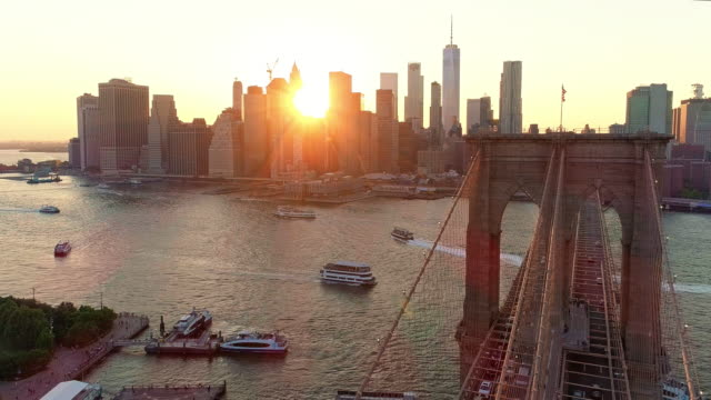 The aerial scenic view to Manhattan Downtown and Brooklyn Bridge from Brooklyn Heights over the East River at the sunset. video