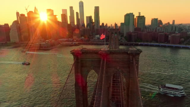 The aerial scenic view to Manhattan Downtown and Brooklyn Bridge from Brooklyn Heights over the East River at the sunset. Combined forward - climbing camera motion. video