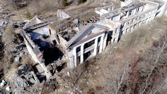 The aerial shot of the ruined big house in ukraine video