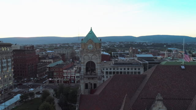 The aerial view of Lackawanna County Courthouse and Downtown District of Scranton at sunset. Pennsylvania, USA. Aerial drone video with the panoramic orbit camera motion.