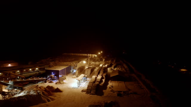 The aerial view of the heap of snow on the ground The aerial view of the heap of snow on the ground inside the industrial site in Estonia construction equipment stock videos & royalty-free footage