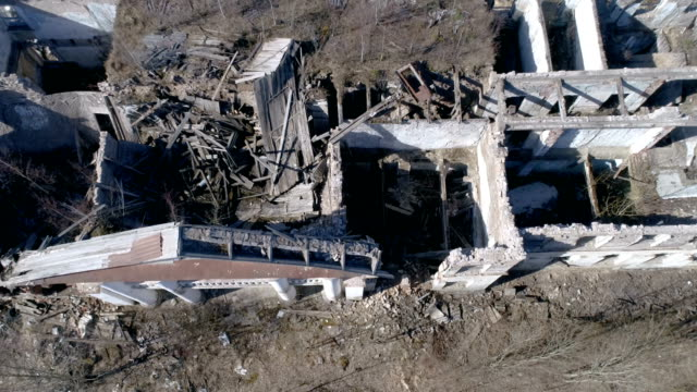 The aerial view of the house with the rubbles video