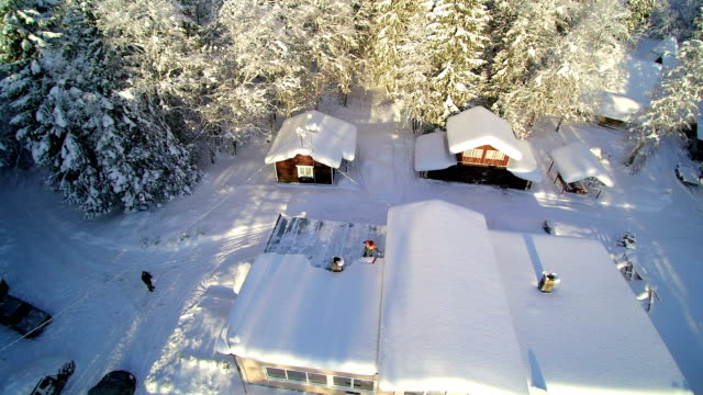 The aerial view of the roof with snow The aerial view of the roof with snow. The roof covered with thick snow on a winter chalet stock videos & royalty-free footage