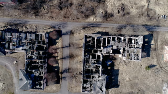 The aerial view of the ruined buildings from the war video