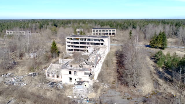 The aerial view of the ruined property from the war video