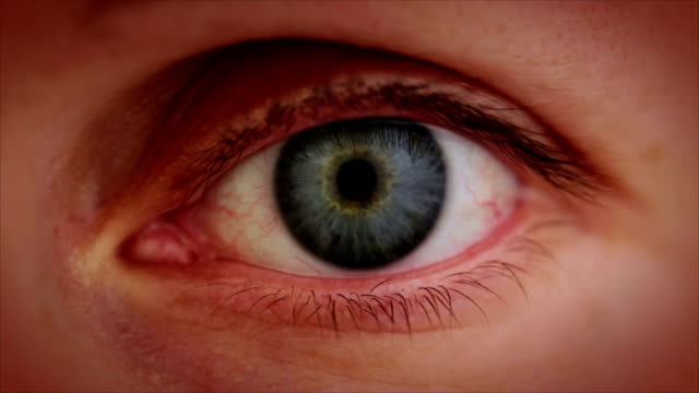 stockvideo's en b-roll-footage met the aging eye. close-up - morphing
