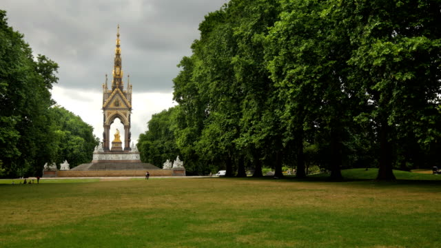 The Albert Memorial in Kensington Gardens, London. Long shot of the Albert Memorial with the park trees blowing about. victorian architecture stock videos & royalty-free footage