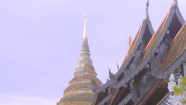 The ancient roofs of The assembly hall and The brickwork of large chedi in Wat Lok Molee in Chiang Mai.