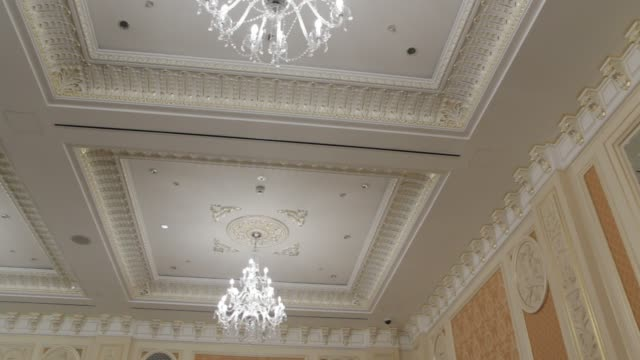 The Antique Interior The antique interior ceiling chandelier symmetry design style mirror architecture royalty stock videos & royalty-free footage