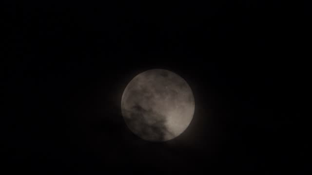 The April Pink supermoon Dark clouds pass by tonight's full moon, a supermoon known as the Pink Moon, as seen from Wakefield, Yorkshire. low lighting stock videos & royalty-free footage