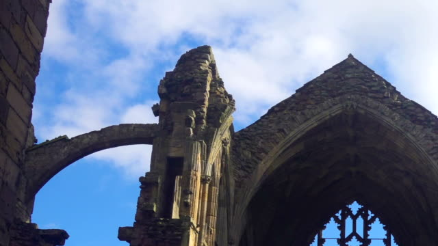 the arch windows of the ruins of melrose abbey in scotland - neo gothic architecture stock videos & royalty-free footage