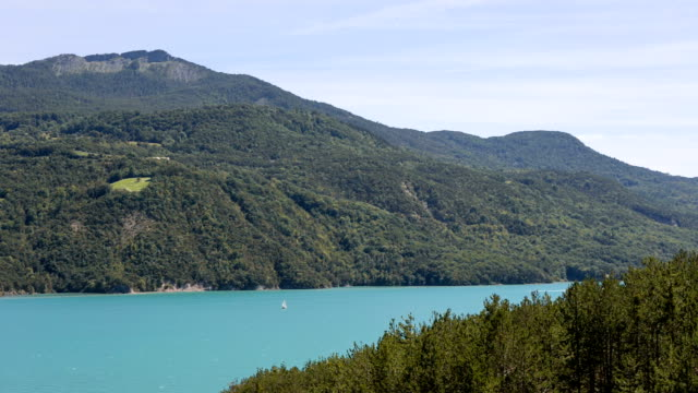 the artificial lake serre-poncon in the french alps. the lake water is used for irrigation of agricultural fields. france. - barrage de serre poncon stock videos & royalty-free footage