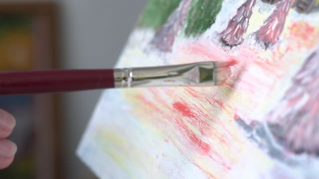the artist paints a picture with oil video