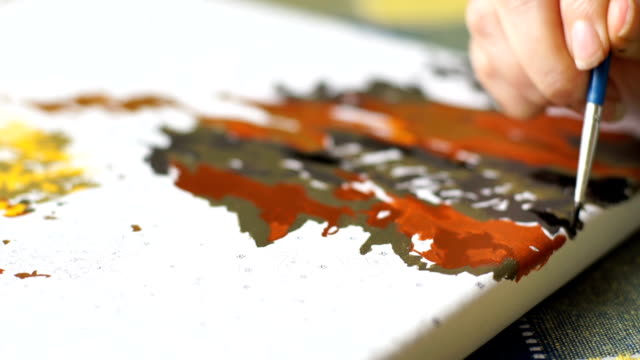 The artist paints a picture with paints video