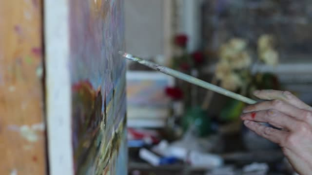 The artist paints in the Studio oil painting video