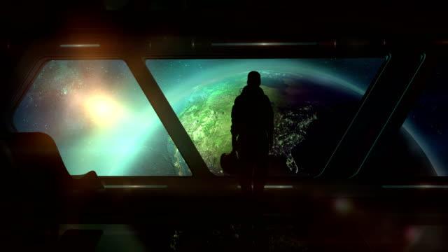 the astronaut in the ship flies to earth - континент географический объект стоковые видео и кадры b-roll