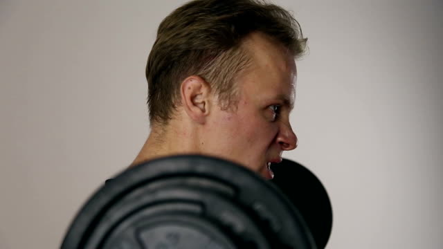 The athlete lifts the barbell video