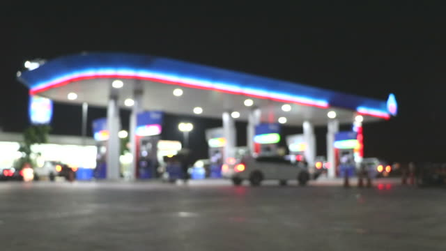 The Atmosphere Lighting Blurred in Gas station at night The Atmosphere Lighting Blurred in Gas station at night station stock videos & royalty-free footage