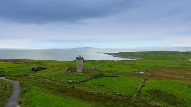 The Ballinalacken Castle in West Ireland in an aerial view video