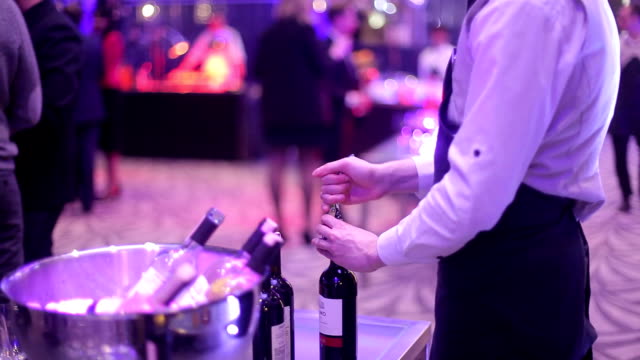 the bartender opens wine corkscrew video