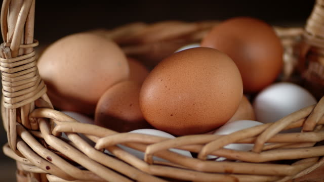 The basket with fresh raw eggs rotates slowly.