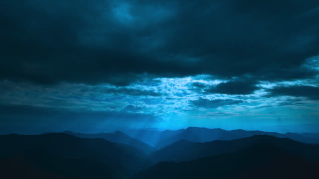 The beautiful cloud flow above mountains on a moonlight background. time lapse The beautiful cloud flow above mountains on a moonlight background. time lapse mountains in mist stock videos & royalty-free footage