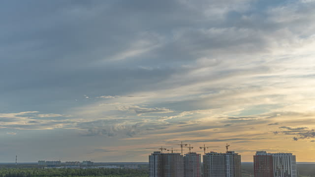 The beautiful view on sky over the cityscape. time lapse