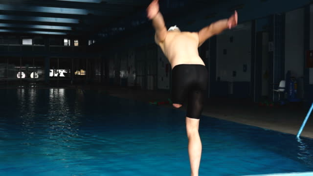 The benefits of swimming no matter what your ability Man with disability jump in to swimming pool amputee stock videos & royalty-free footage